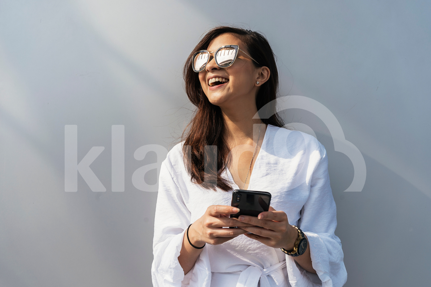 Portrait of beautiful Asian woman using mobile