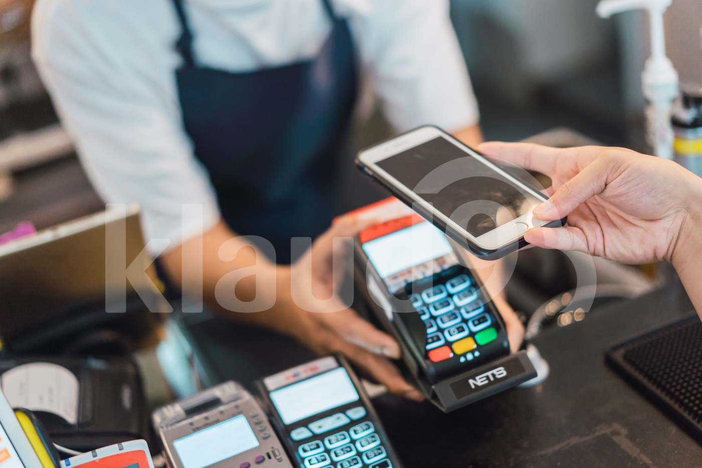 Woman paying bill through smartphone