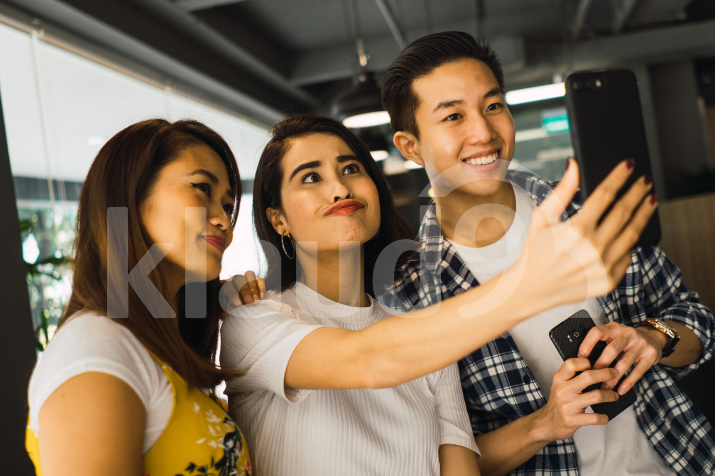 Asian millennials taking selfie