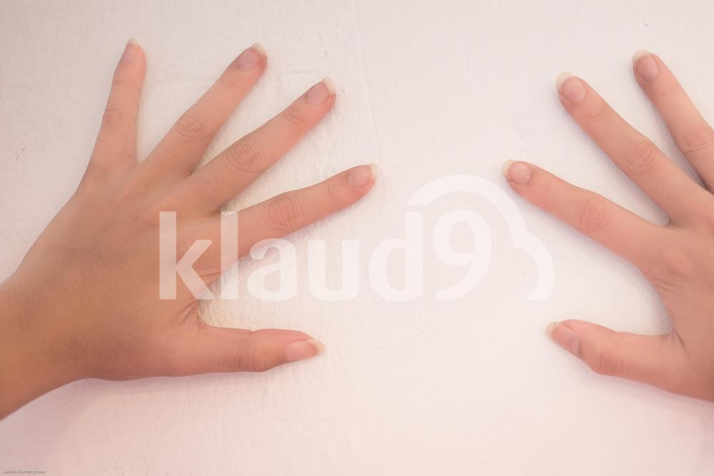 Hands on wall