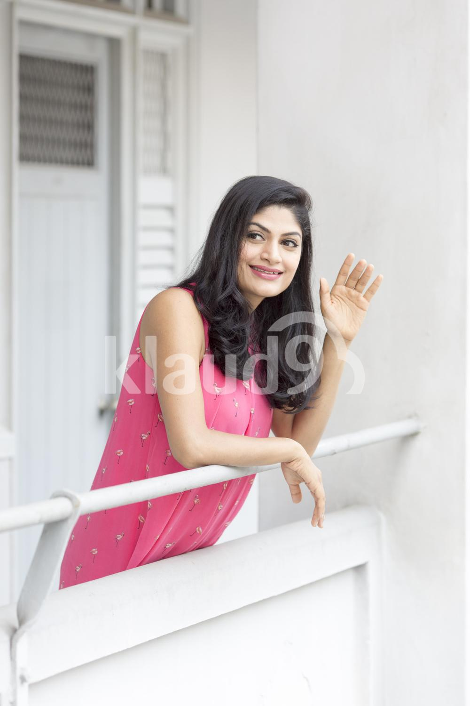 Pretty Indian woman waving