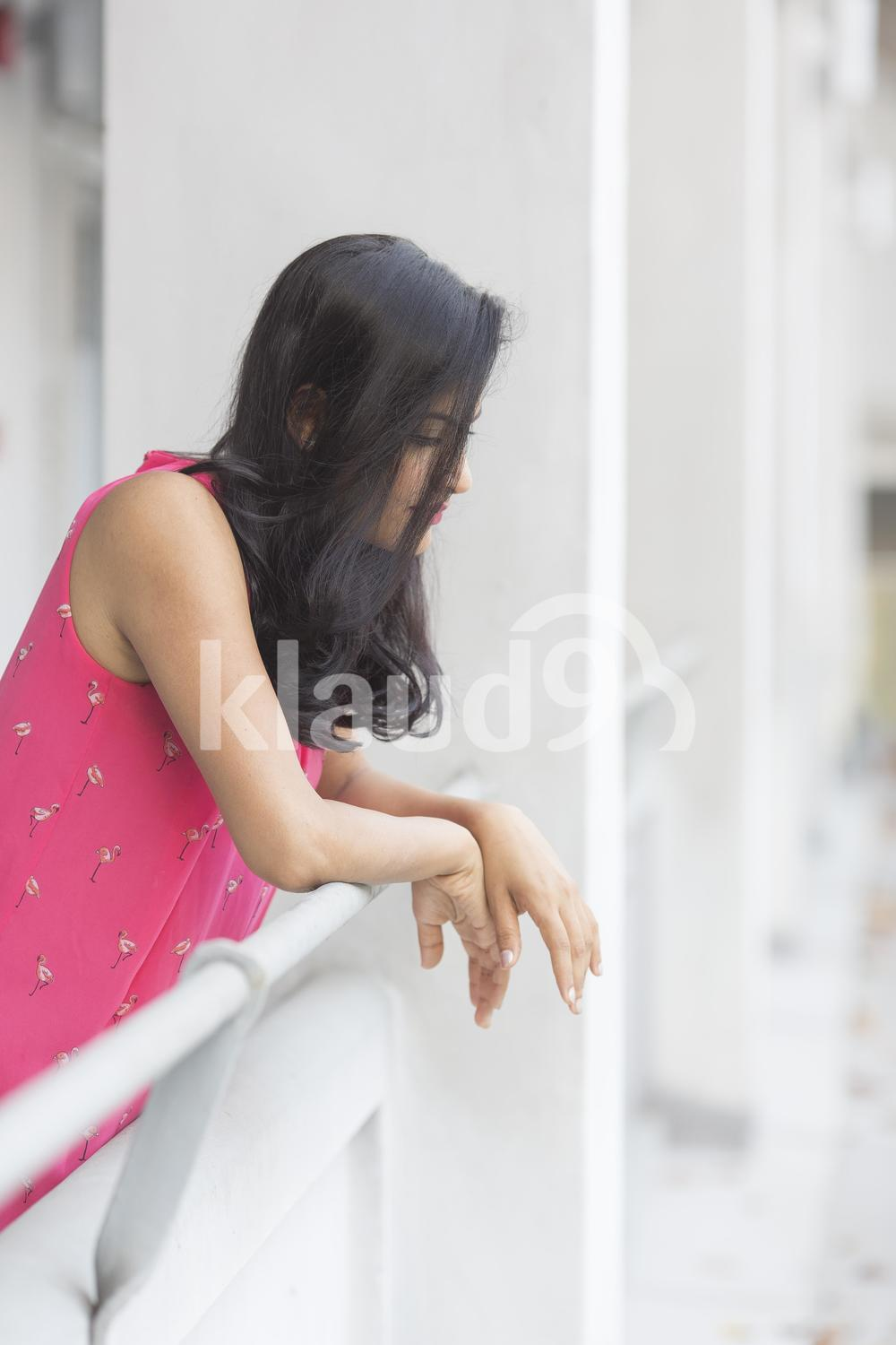 Young Indian woman looking down