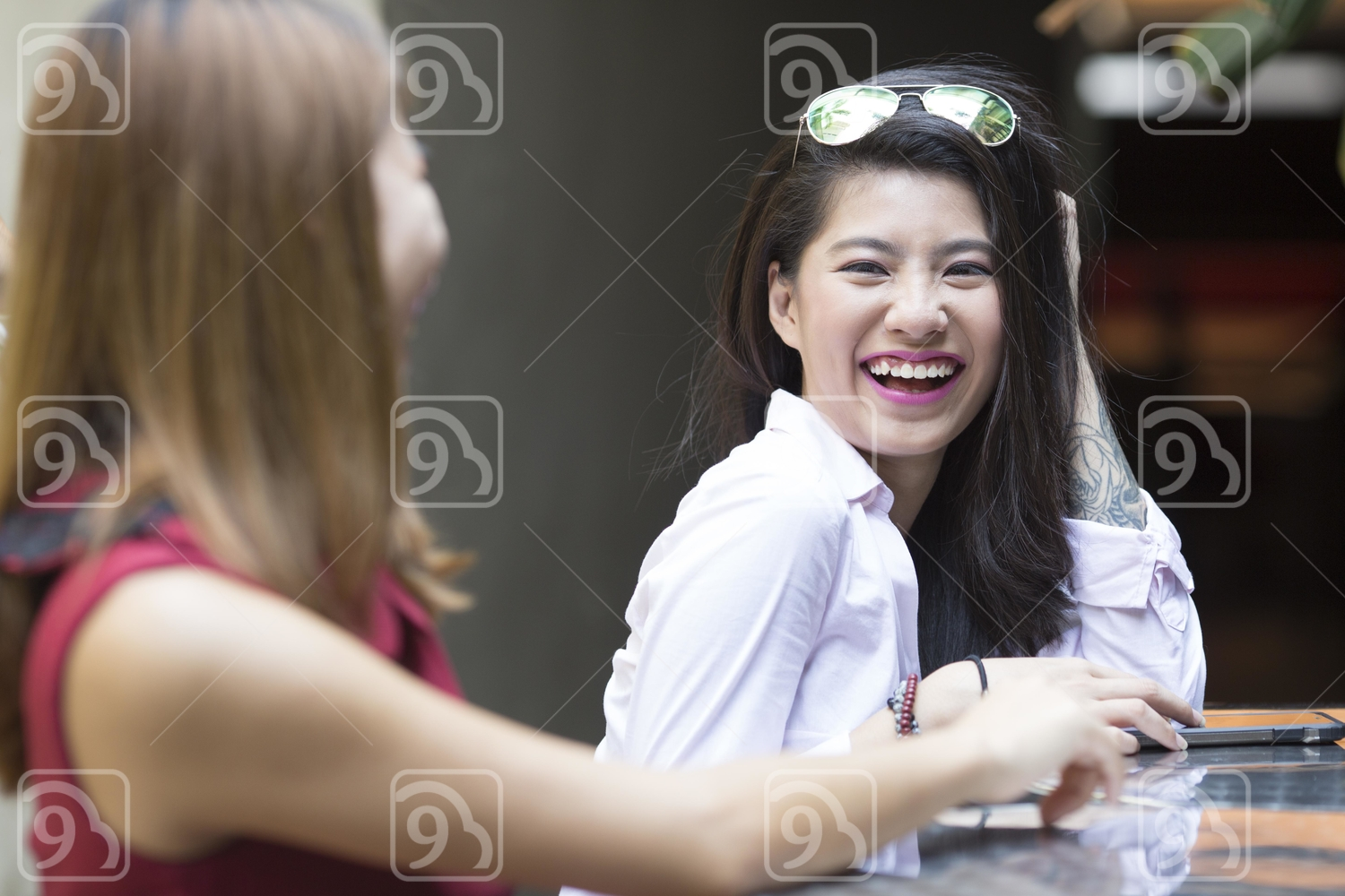 Young women laughing
