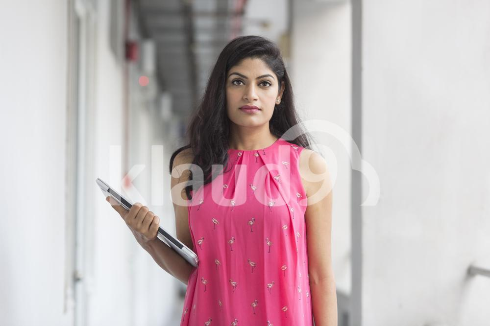 Portrait of a beautiful Indian lady with laptop