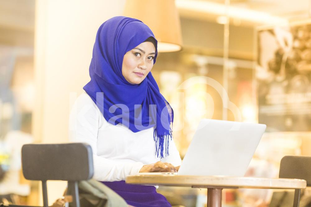 Professional woman working at a laptop
