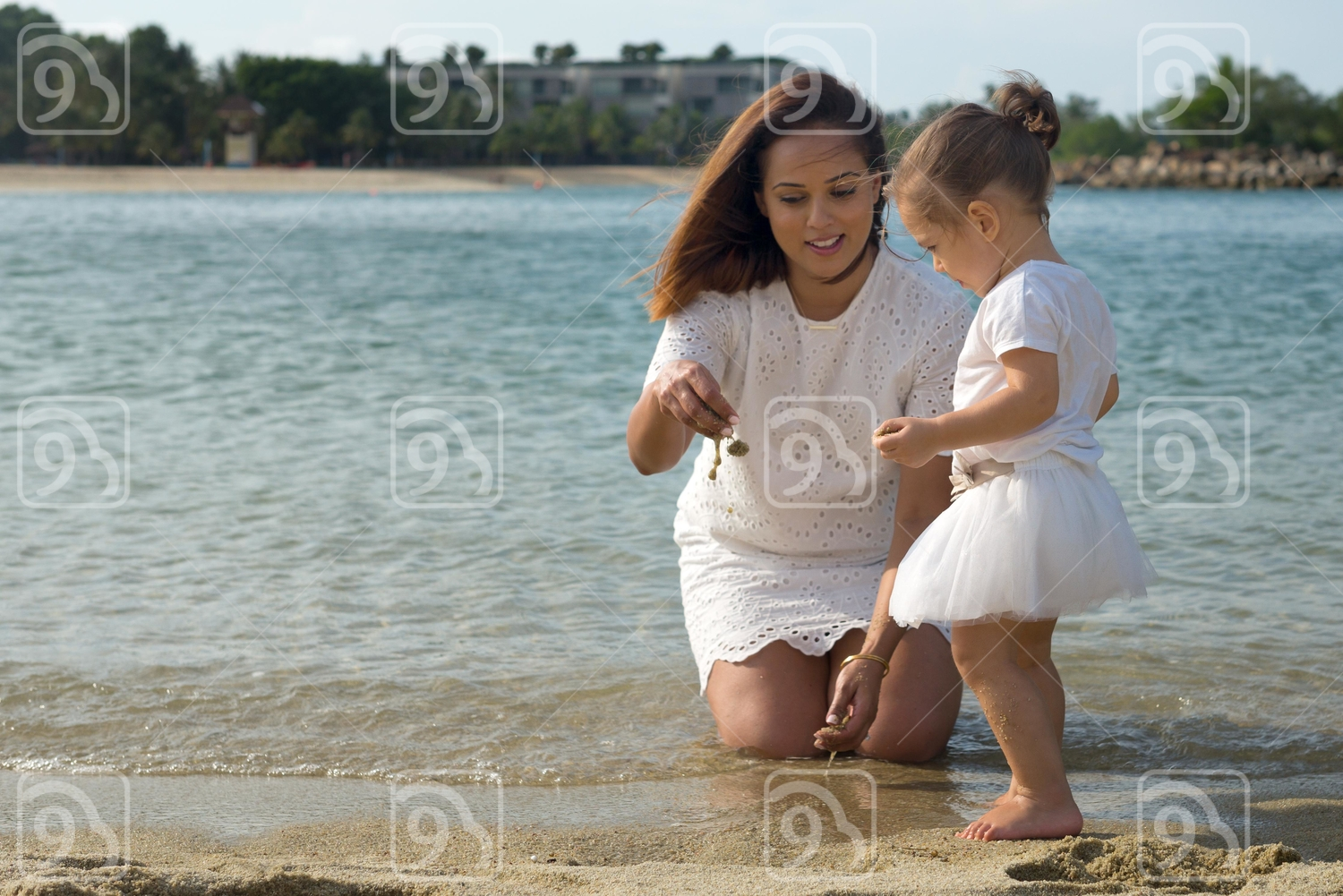 Mom and daughter at the beach