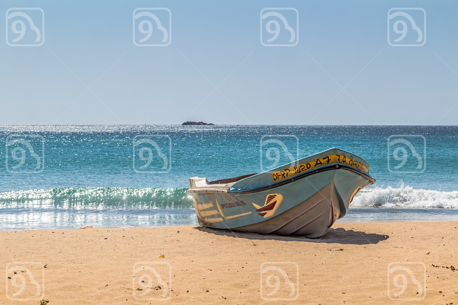 The boat on the sandy shores of the Indian Ocean. Sri Lanka