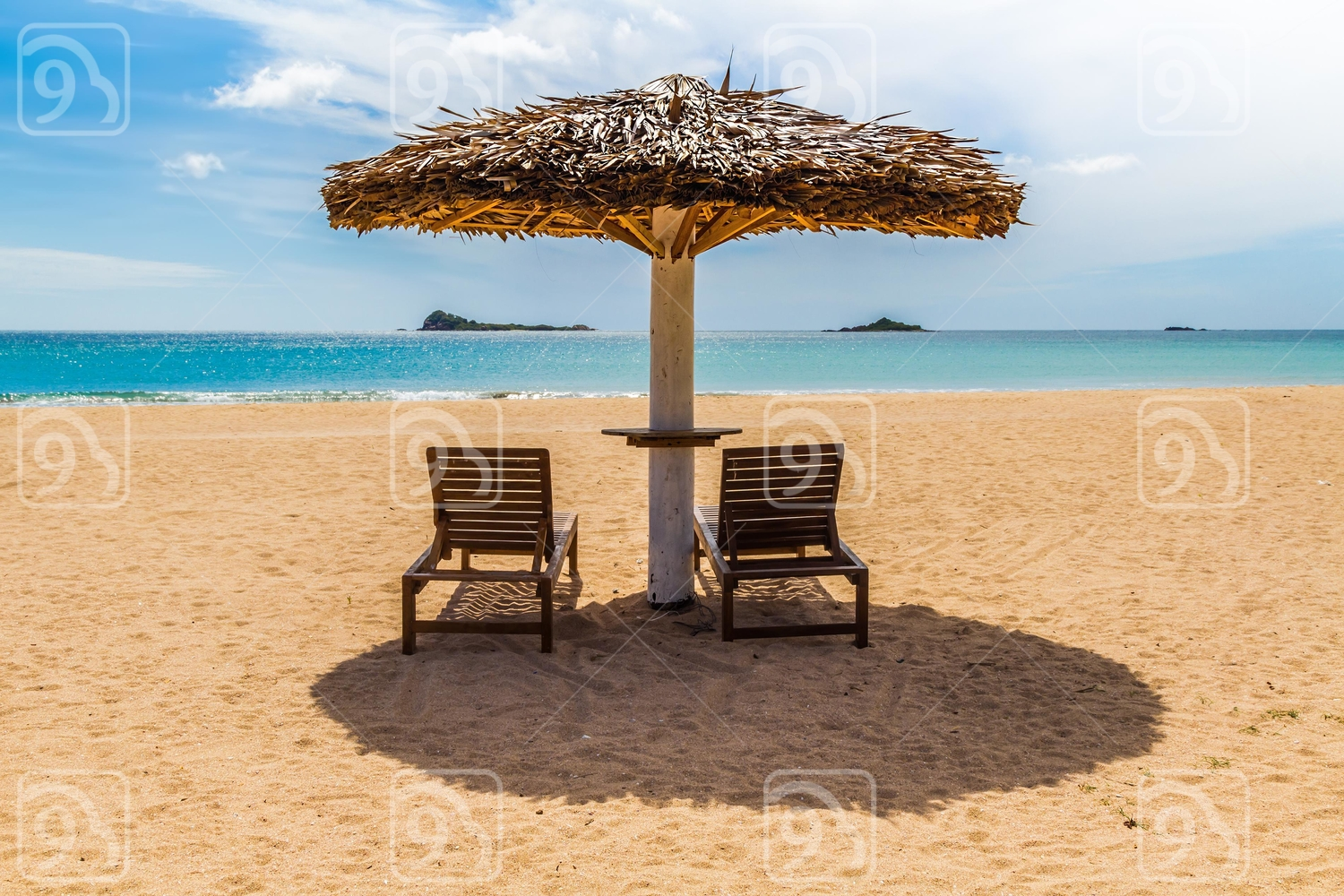 Two deck chairs on a deserted tropical beach in Sri Lanka
