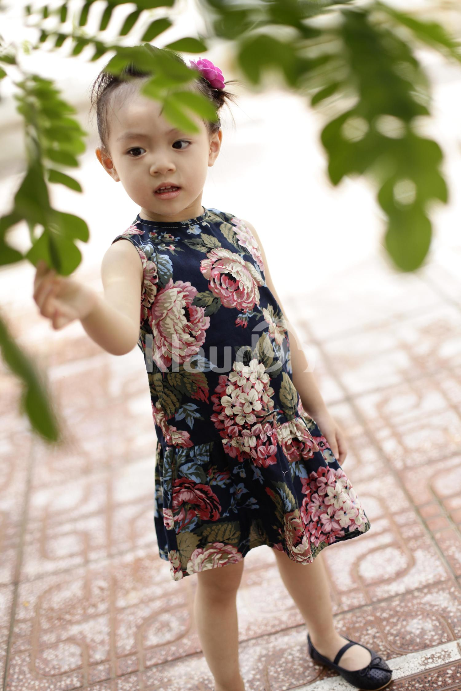 Cute Vietnamesse little girl in floral dress