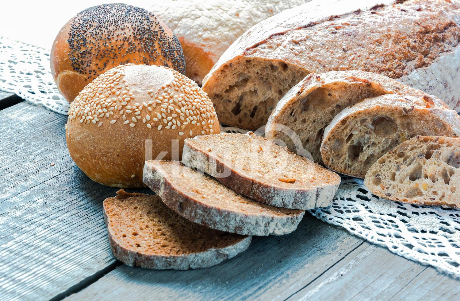 bread and buns lying on a wooden board
