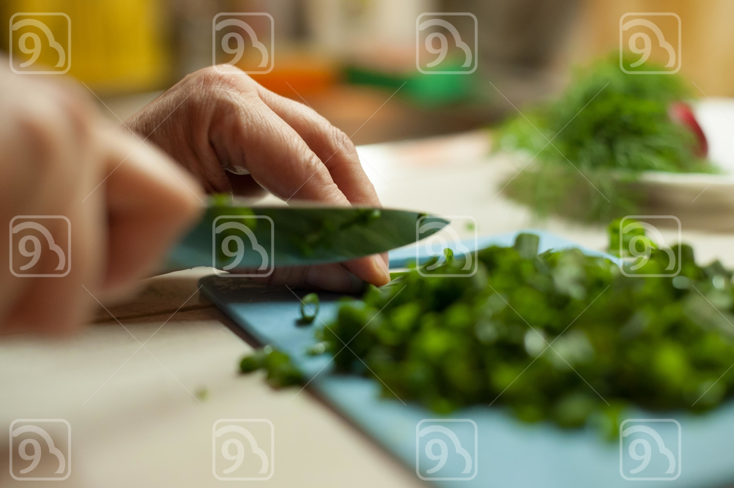 Woman cutting vegetables with a knife