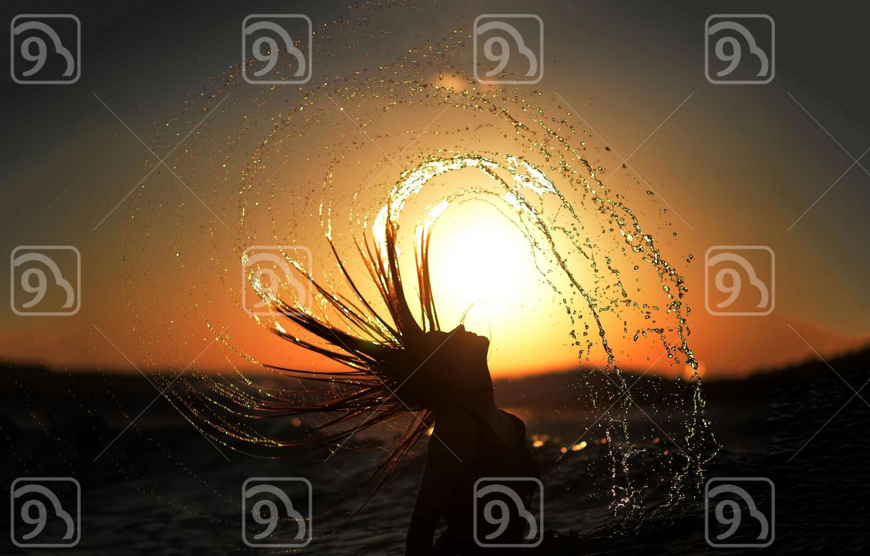 Woman swinging hair