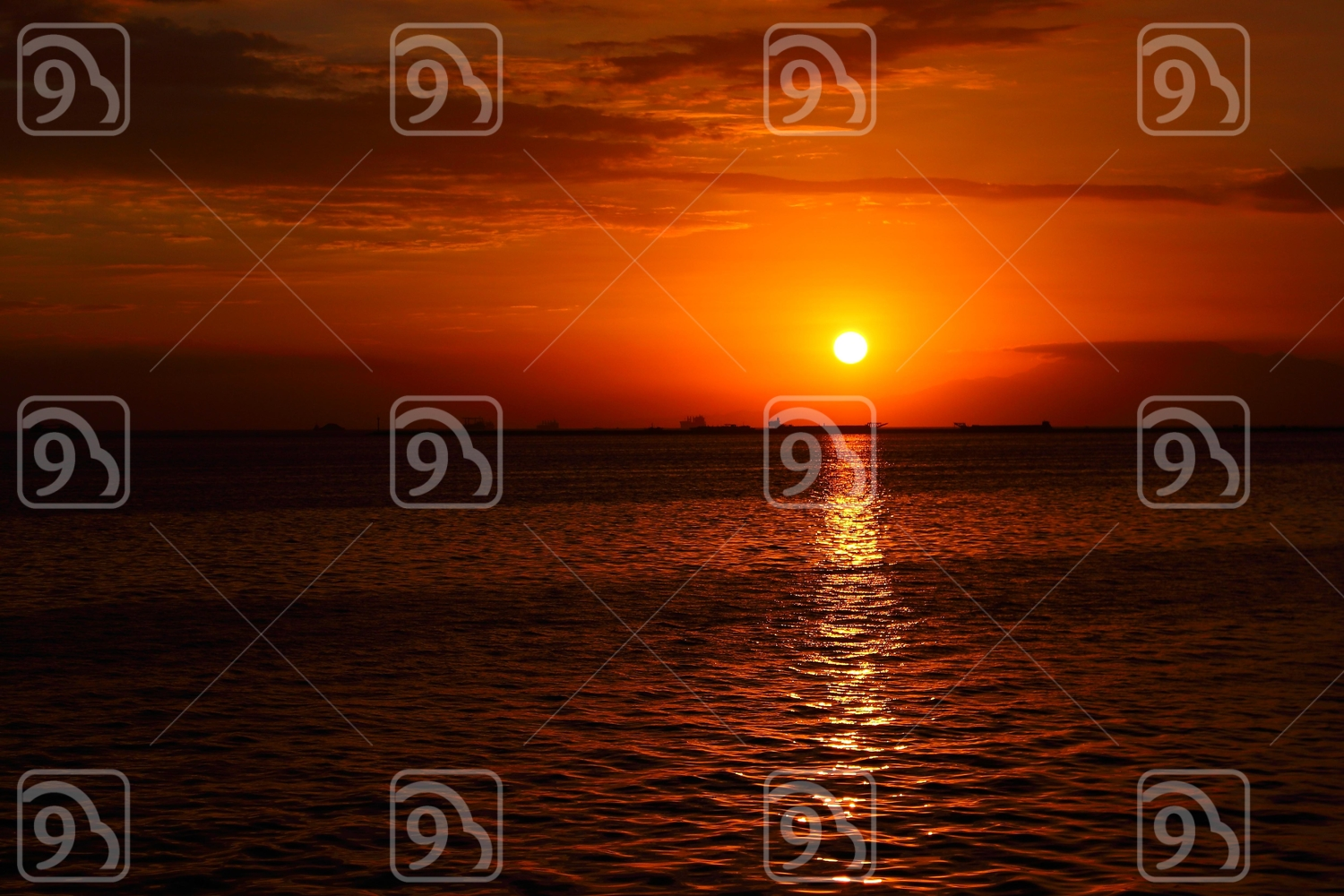 Sunset at the Bay with the sun's reflection on the water
