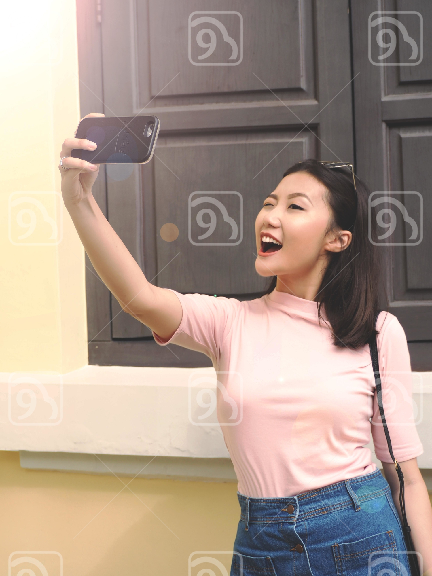 Chinese girl taking a selfie