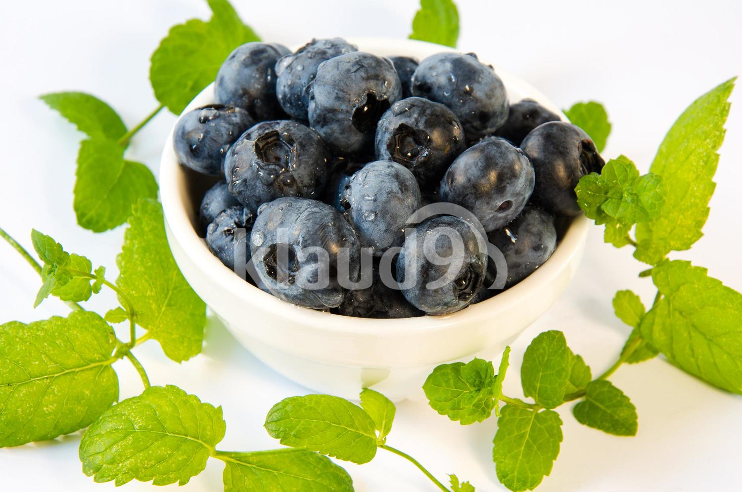 blueberries in a plate on a table