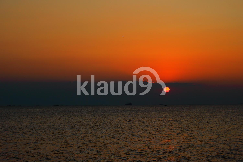 Sunset within  Dark Clouds