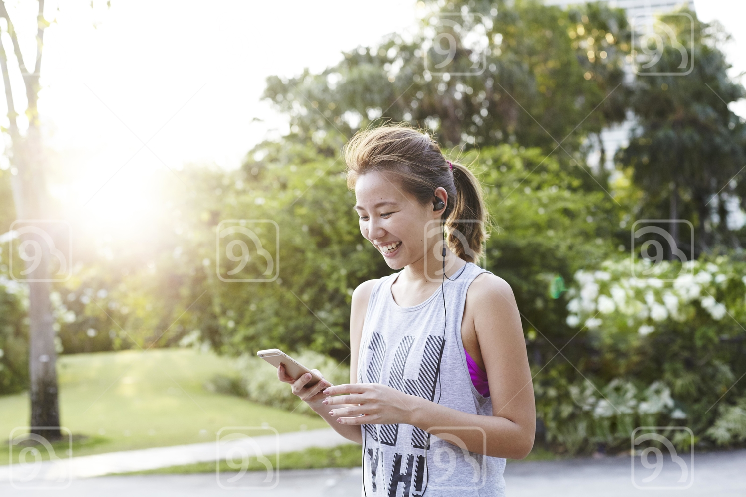 Beautiful Smiling Woman Checking out her handphone