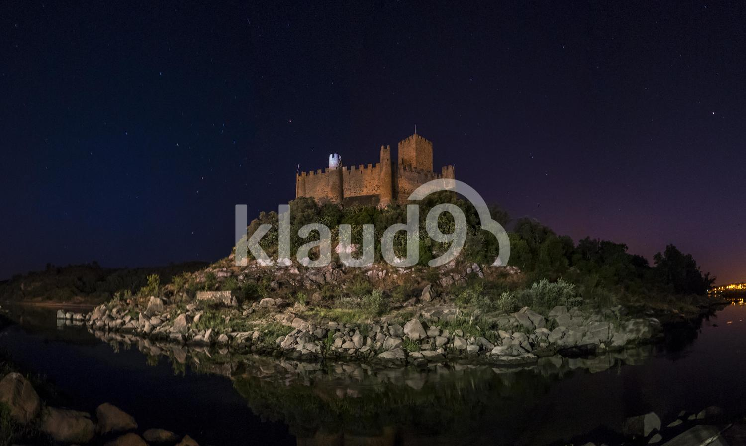 Castle in river by night