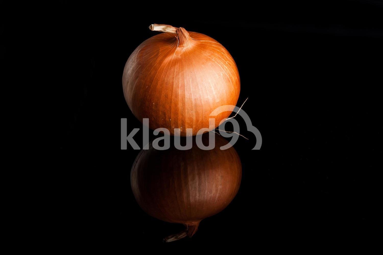 Gold onion on black