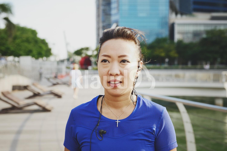 Portrait of Woman Running at Marina Bay Sands