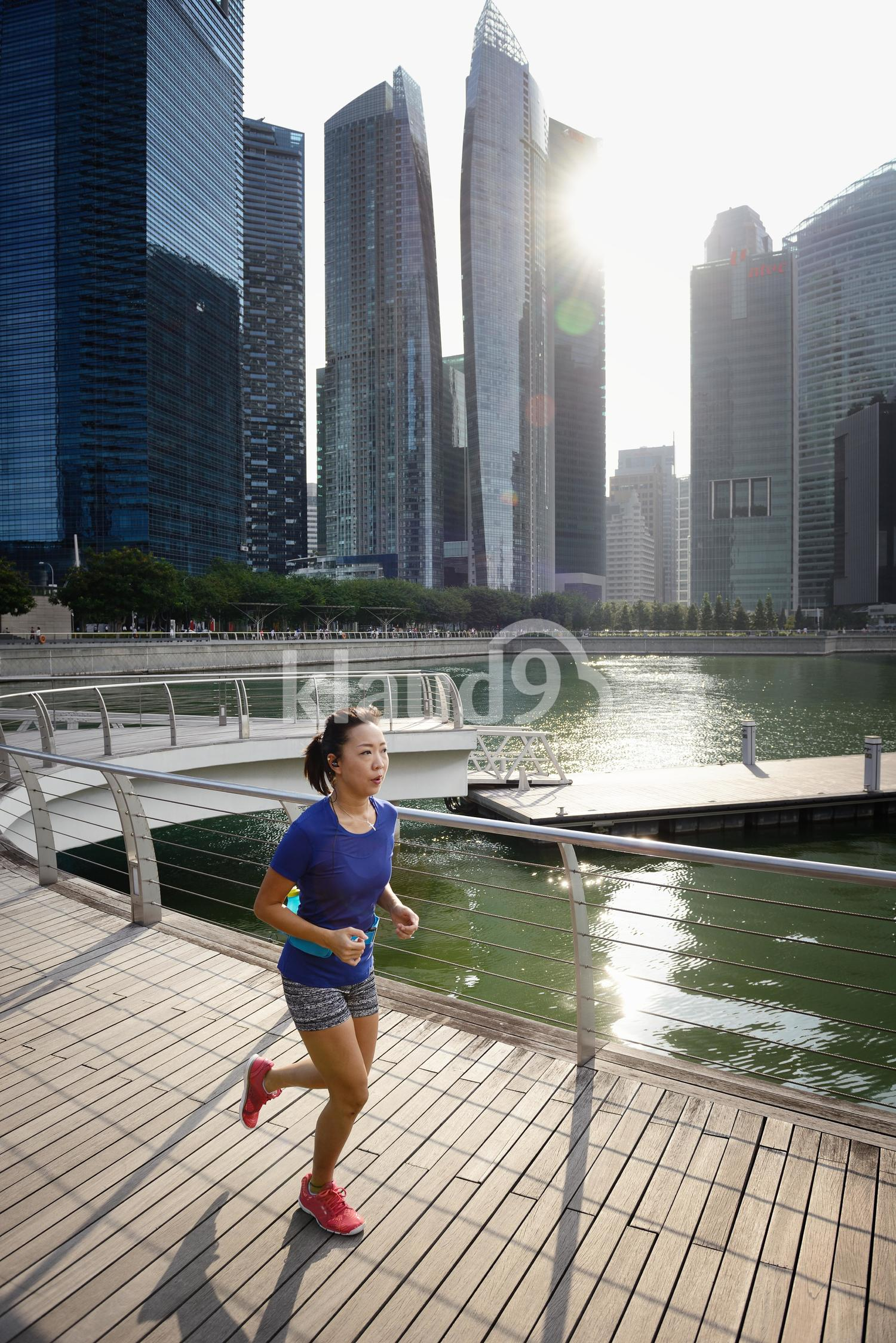 Portrait of Woman Running at Marina Bay Sands