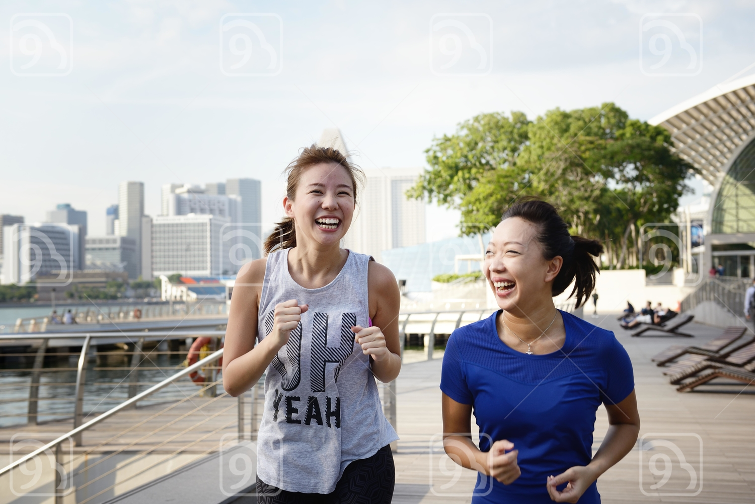 Two Women Running at Marina Bay Sands