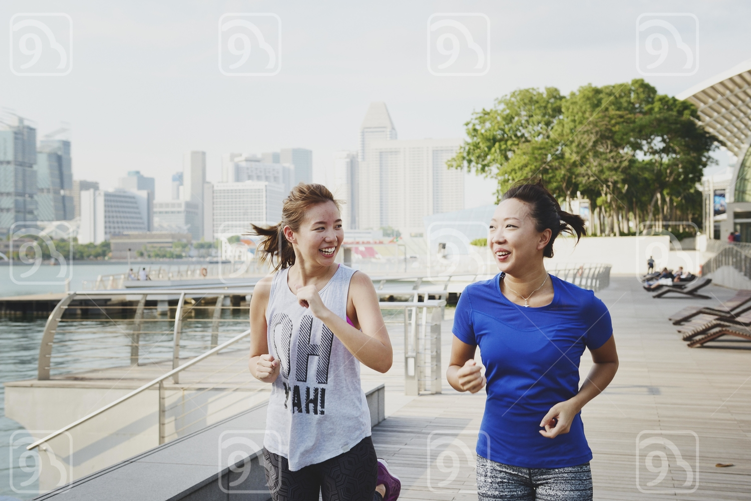 Two Happy Women Running at Marina Bay