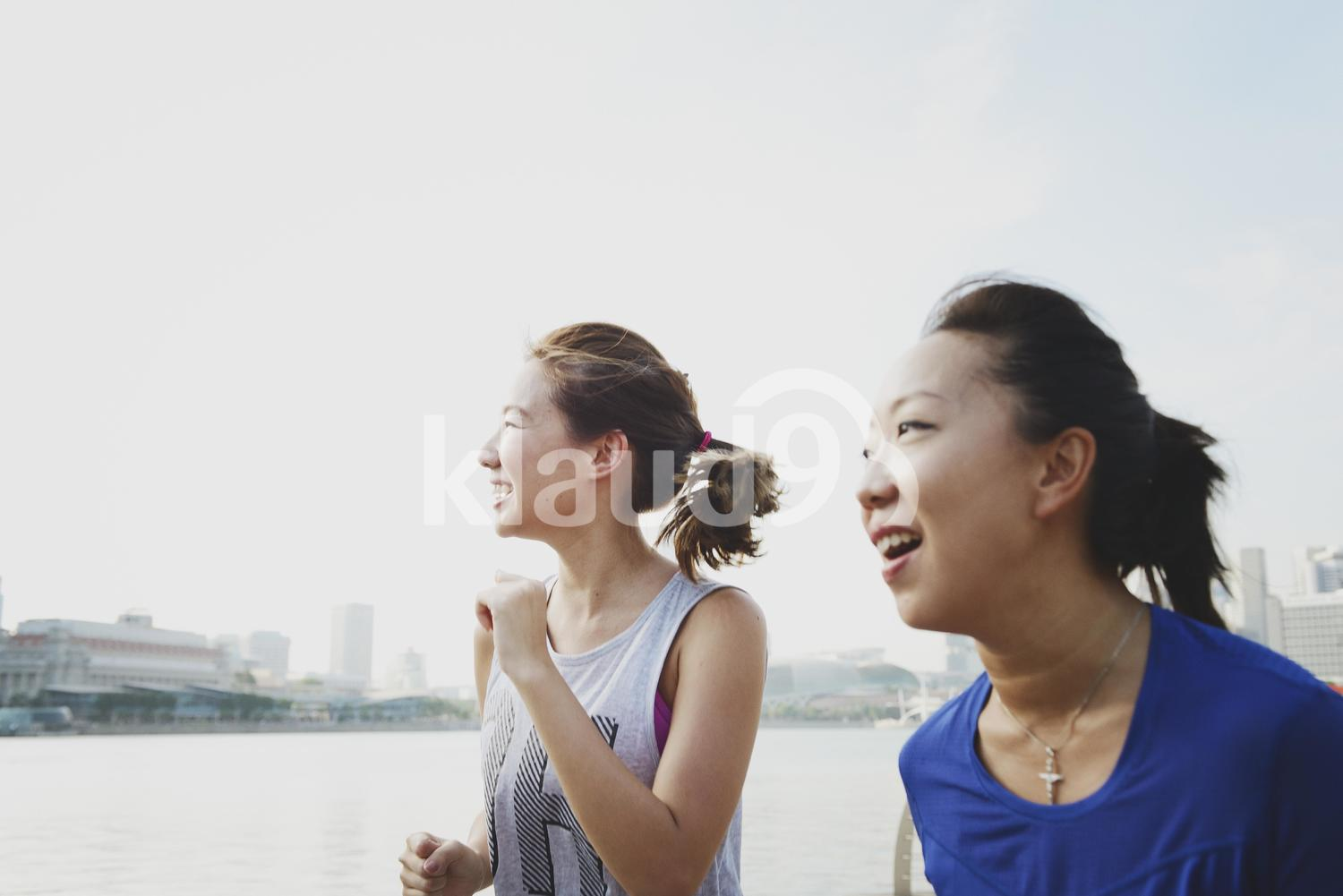 Two Happy Women Running at Marina Bay Sands