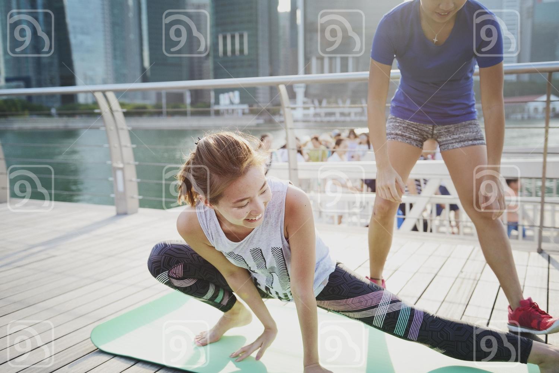 Beautiful Women Practising Yoga