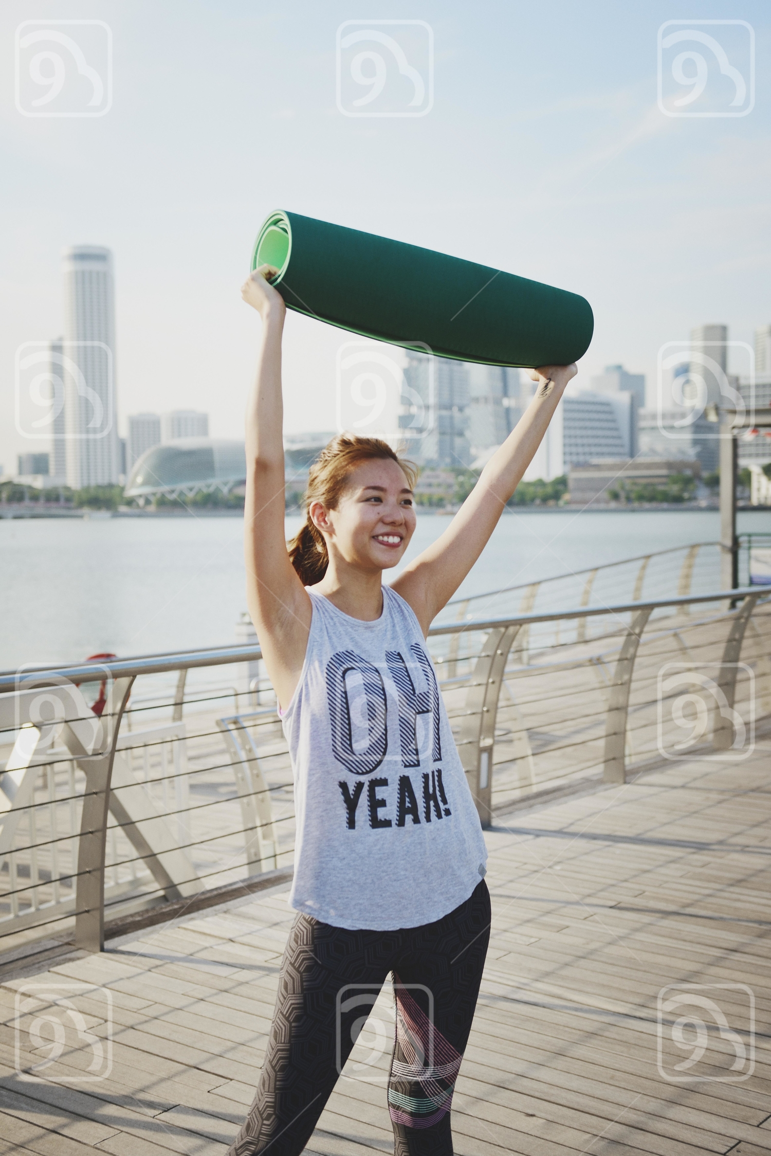 Happy lady with Yoga Mat
