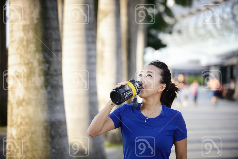 Lady taking a break from running