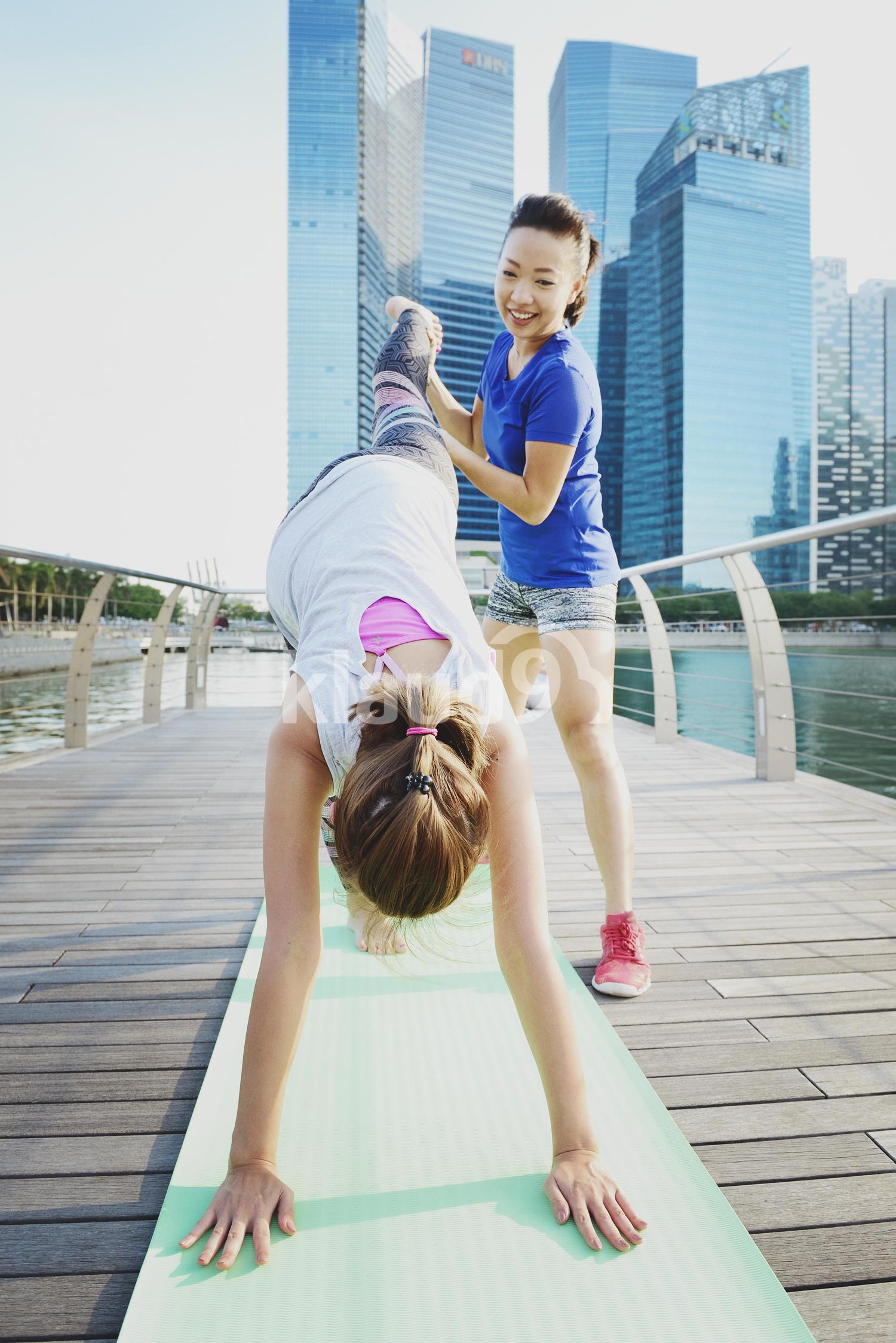 Friends practising Yoga at Marina Bay Sands