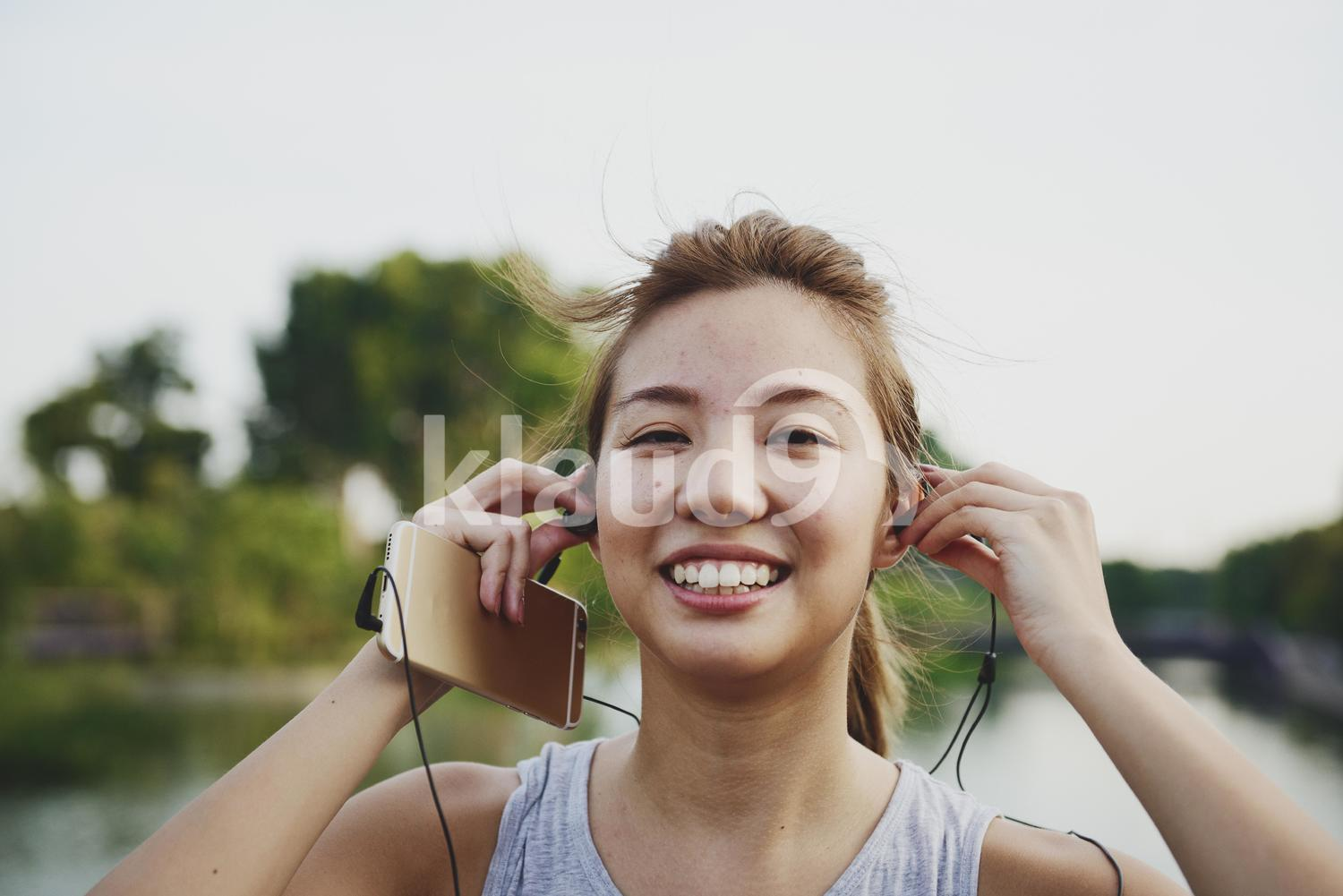 Woman Putting on Earphones before a Run