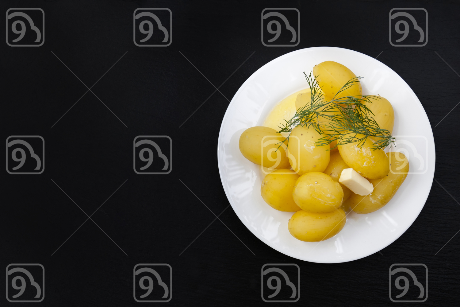 Boiled potatoes in white plate