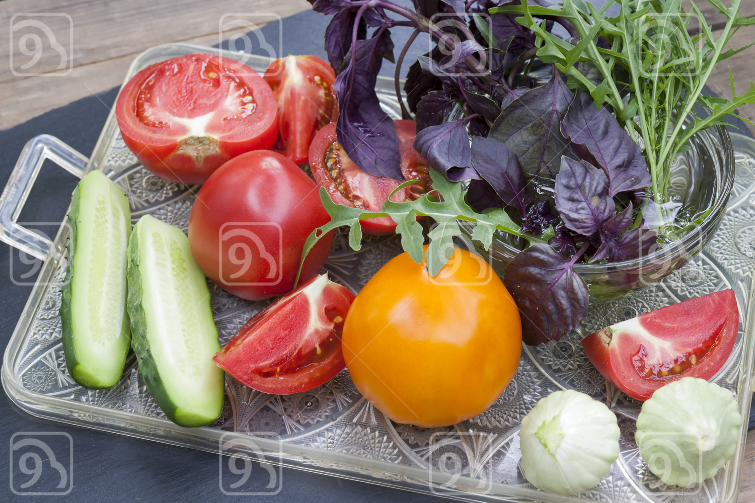 Different ripe organic vegetables and fresh herbs on a tray