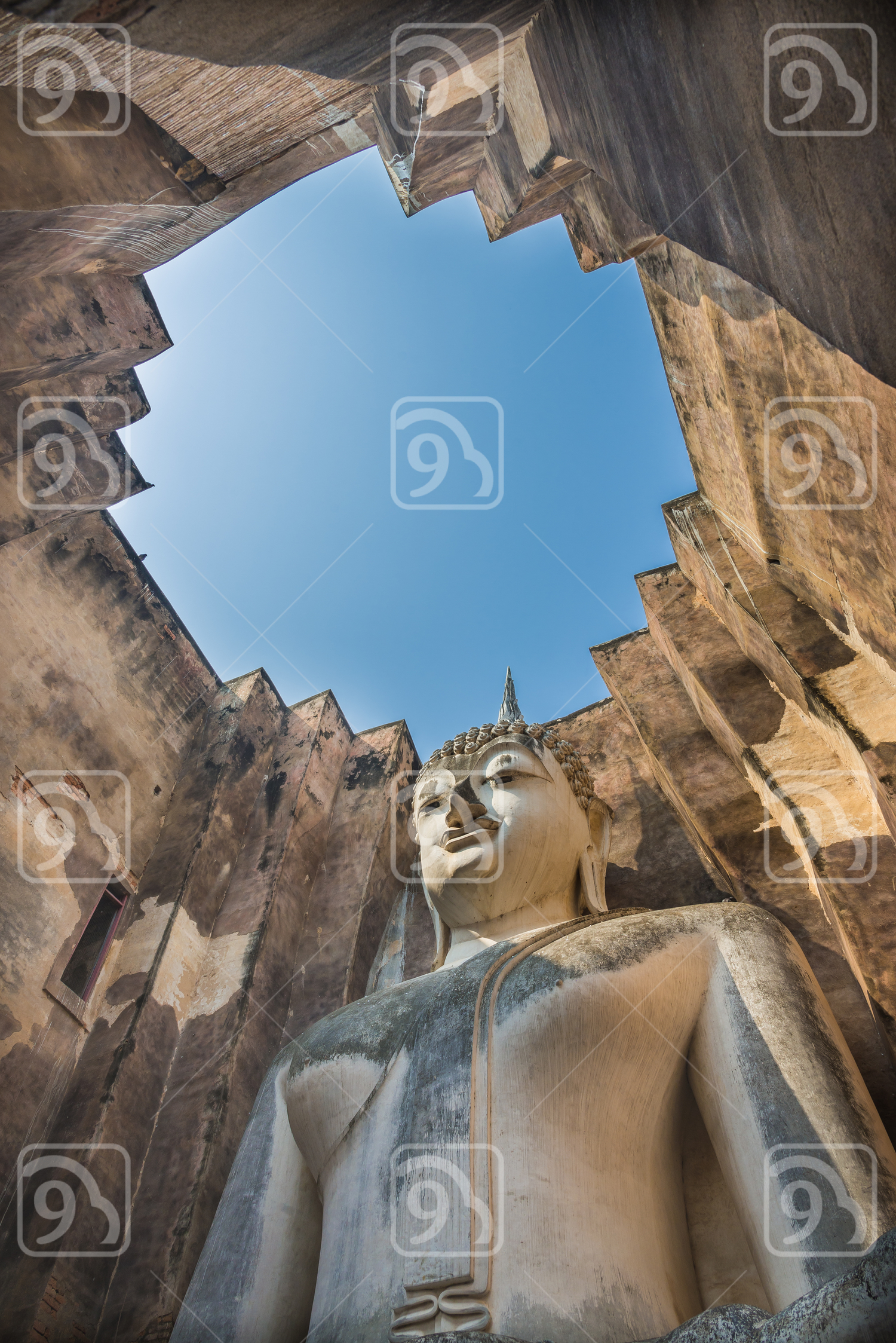 Old sitting Buddha statue in the ancient temple of Thailand