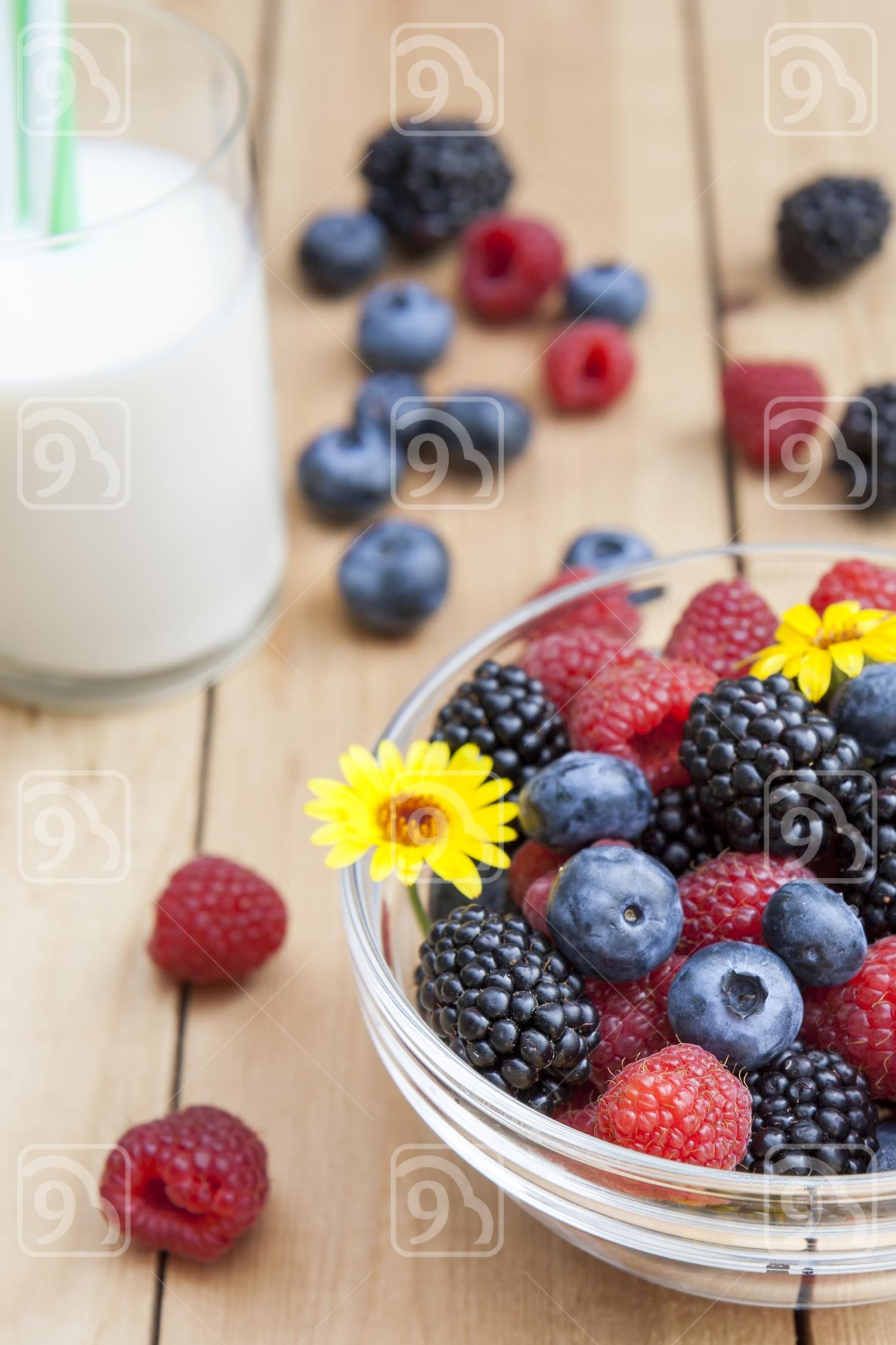 Glass bowl of fresh blackberries, raspberries, blueberries