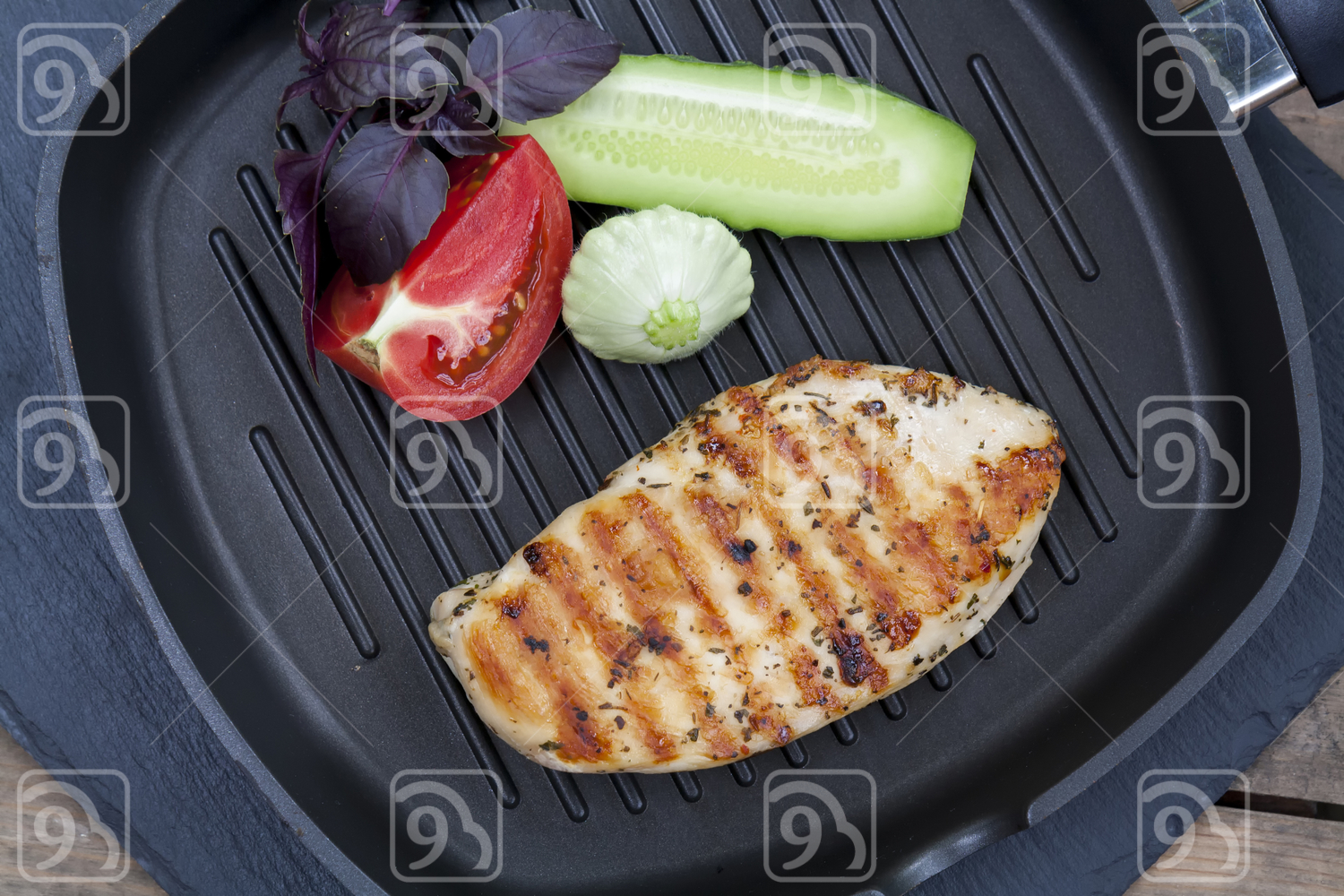 Grilled chicken breast with vegetables and herbs