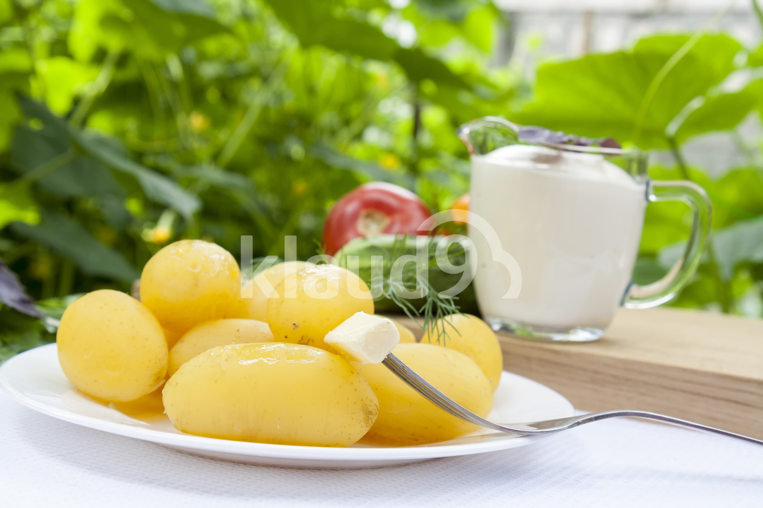 Boiled potatoes with dill and butter