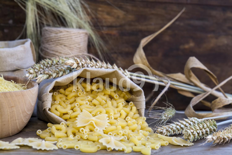 Uncooked Italian pasta Farfalle, Elbow macaroni and Fusilli