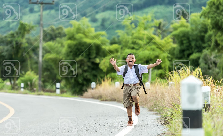 Asia Boy running Back to school