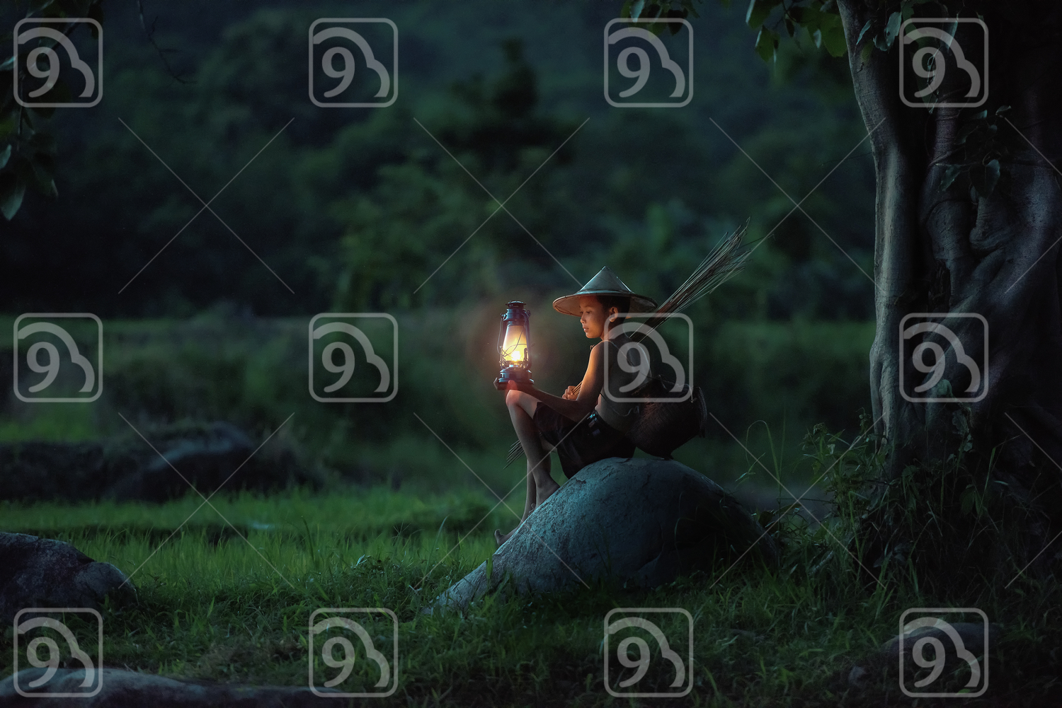 Boy fishing with lantern