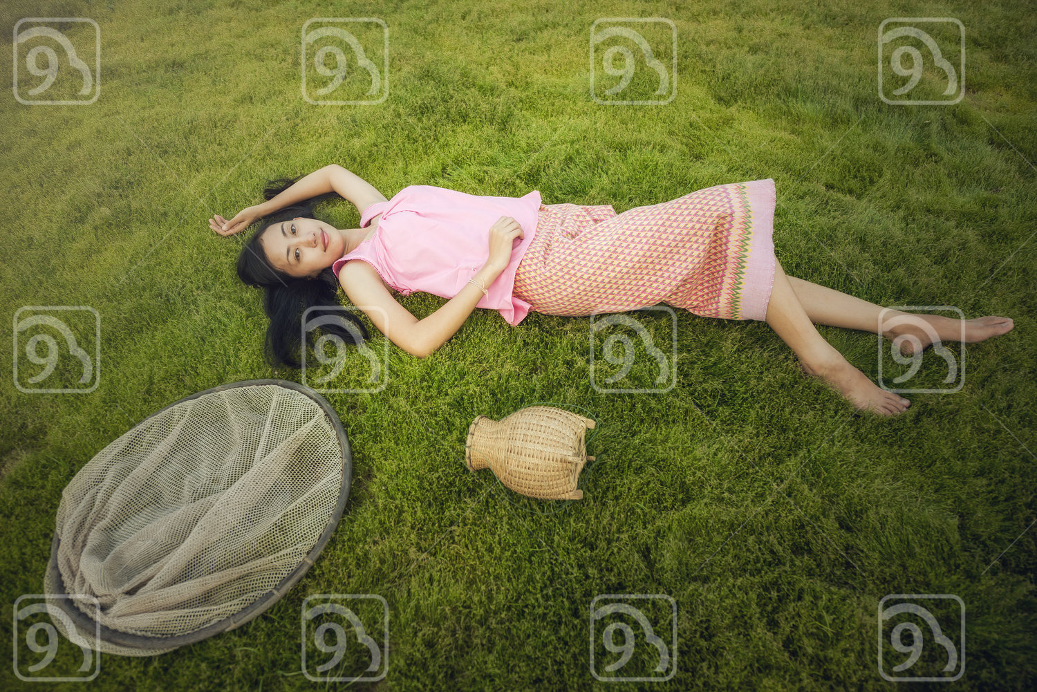 Beautiful Young Woman lying on the field