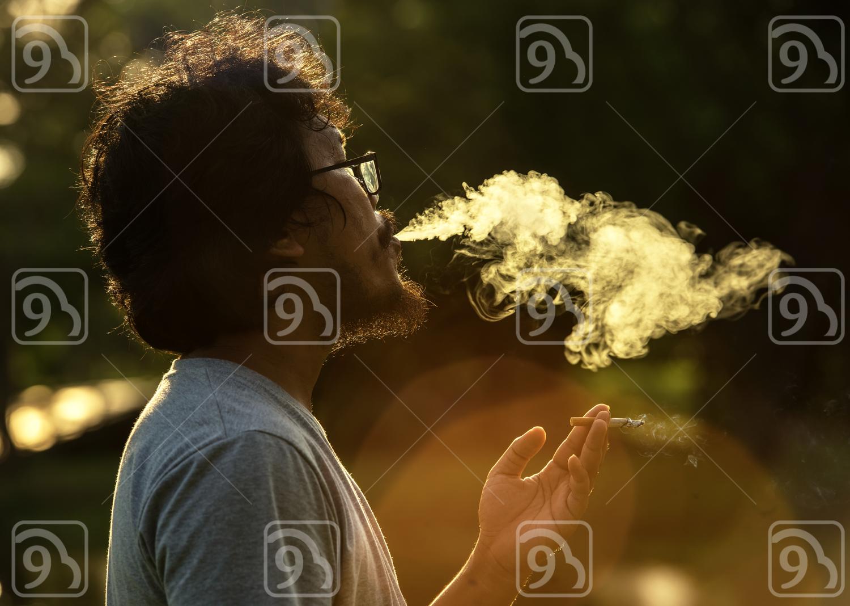 Dark and sullen shot of a man smoking