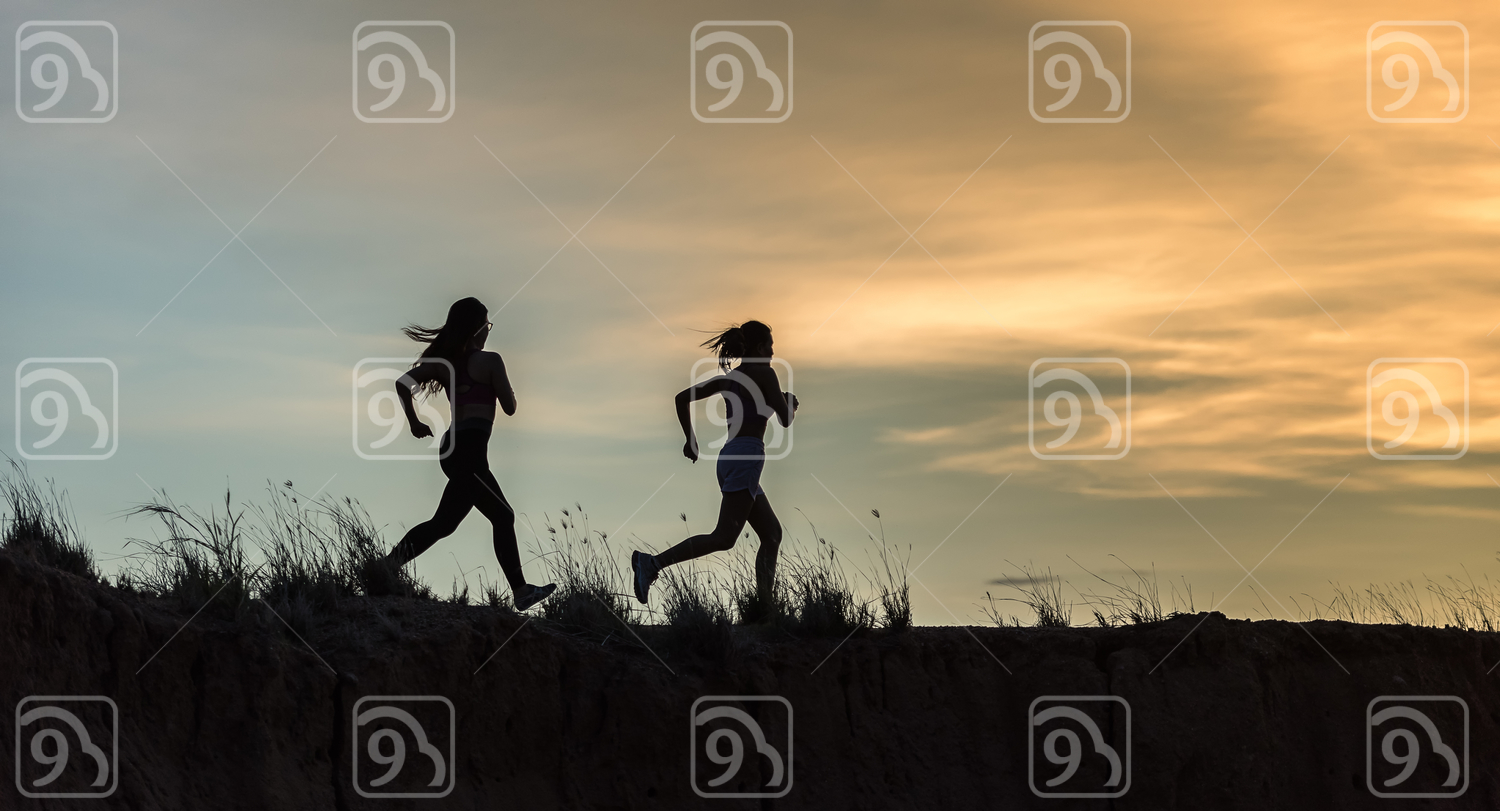 Runner athlete running on trail.