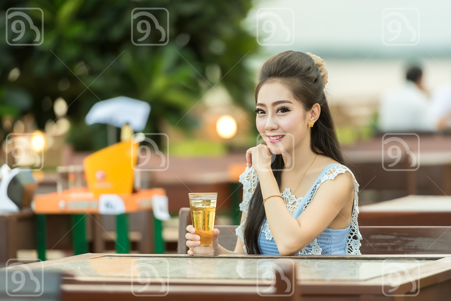 Woman drinking beer on cafe