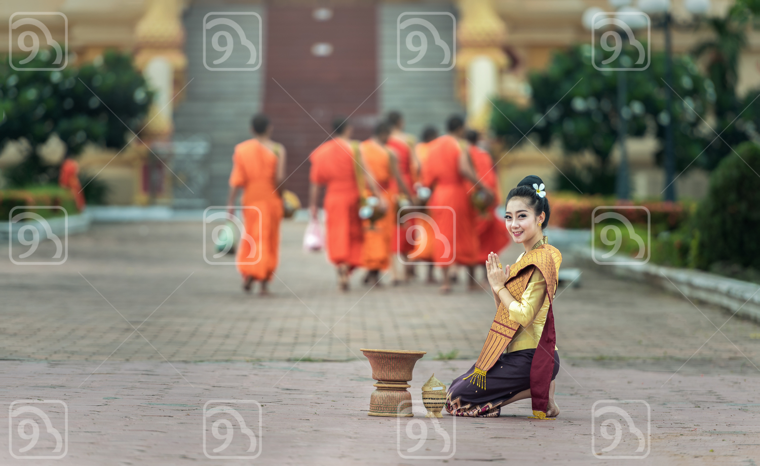 Woman give food offerings to Buddhist monks