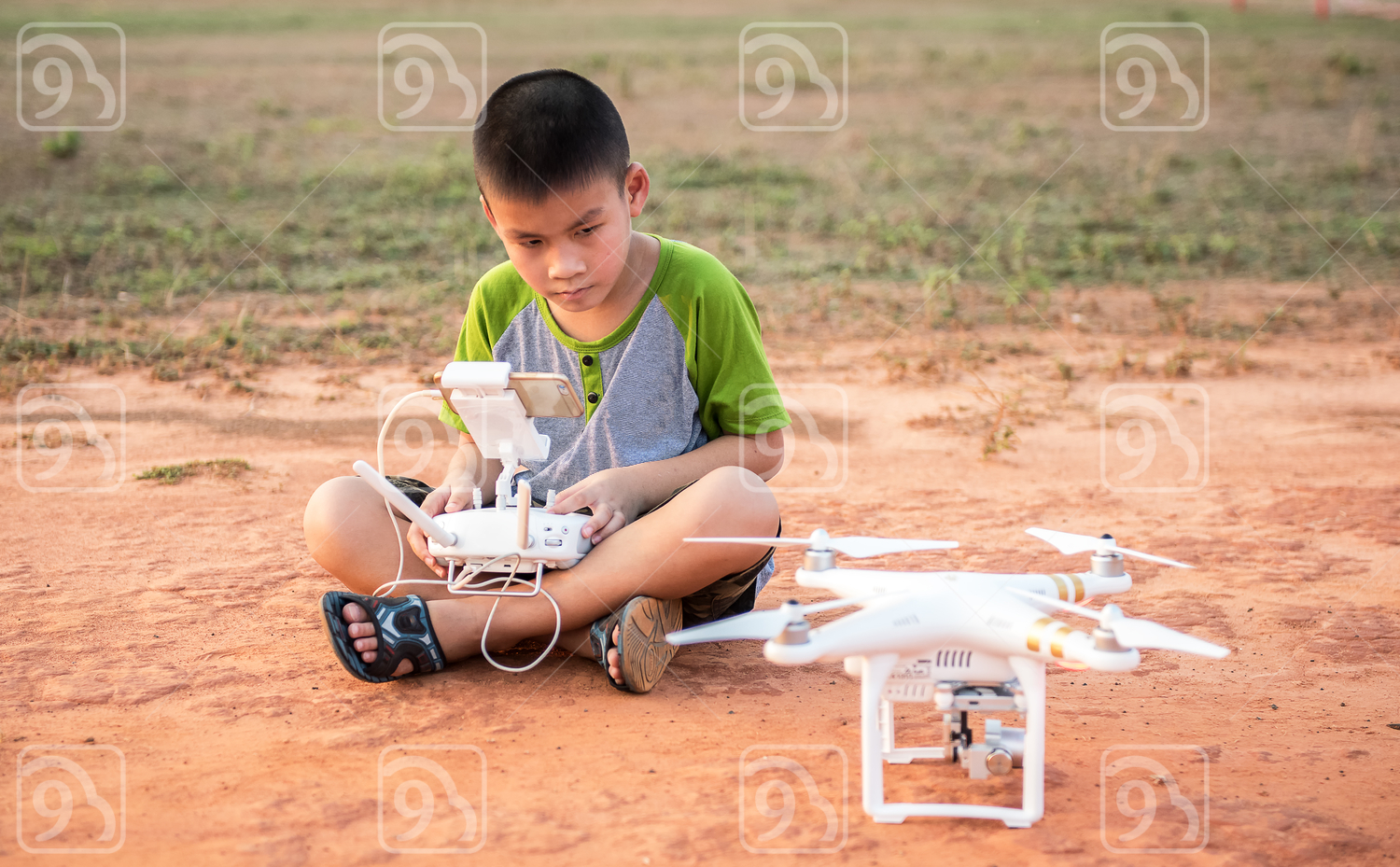 Portrait of kid with quadcopter drone outdoors