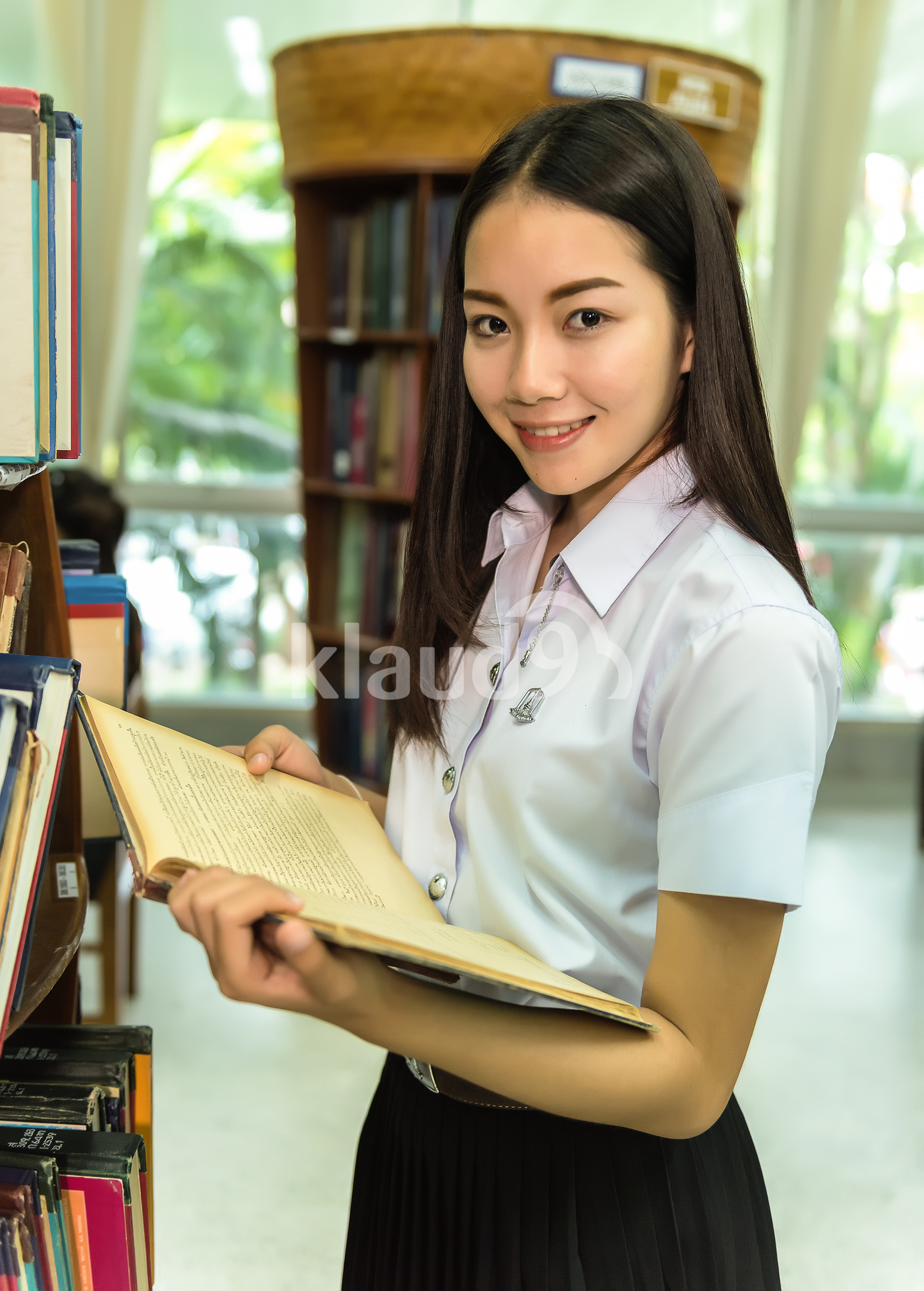 Beautiful student in the library