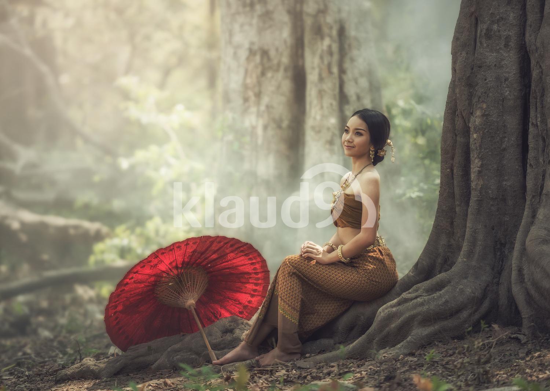 Beautiful Thai girl in Thai traditional costume